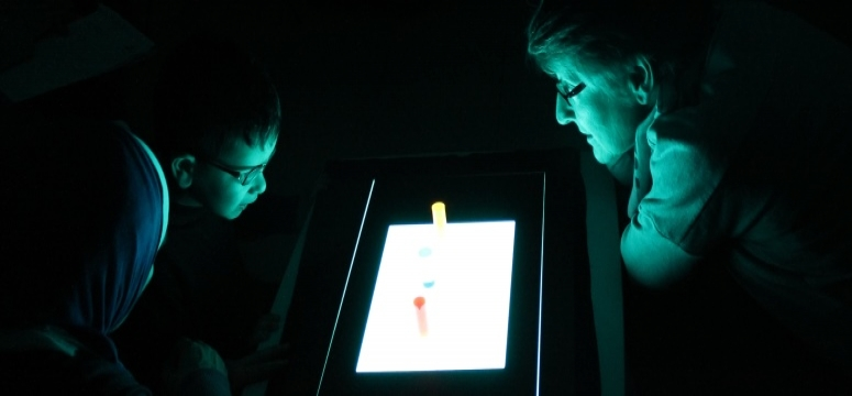 Using a light box to stimulate vision in a child with low vision